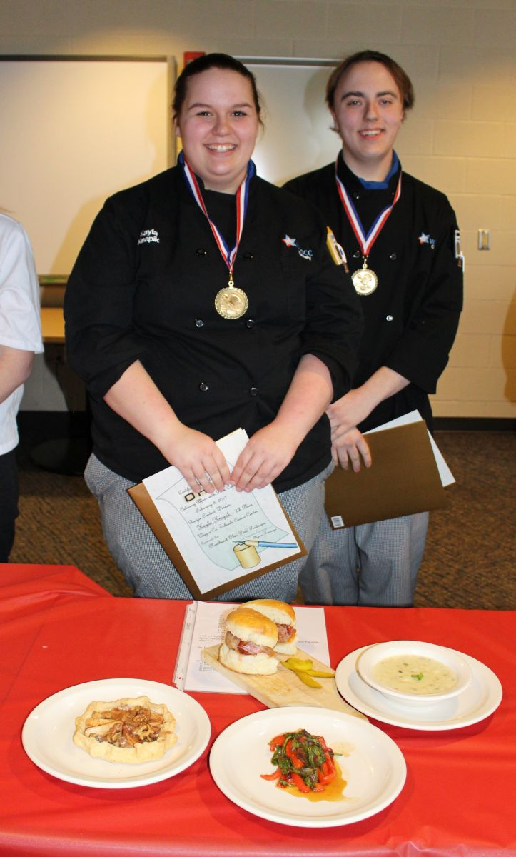 Image of Kayla and Grant, winners of Pork Contest, with meal they prepared