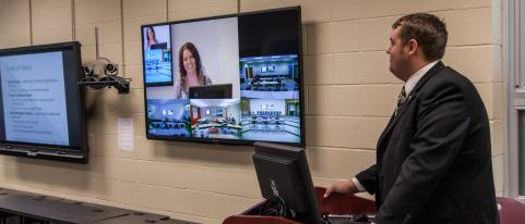 Front screens of what the distance learning classroom looks like