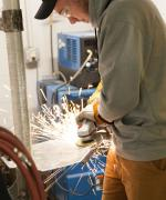 image of a student welding